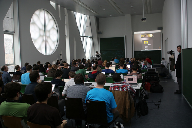 Attendees watch a talk at LGM 2014, in Leipzig. Photo by Manuel Schmalstieg.